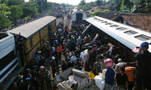 Indonesian police and residents search for victims after a train crash killed dozens
