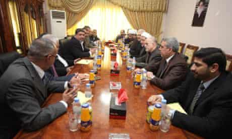 Iraqi representatives of Moqtada al-Sadr and Nouri al-Maliki before announcing they will back Maliki