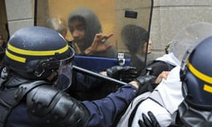 Anti-riot police forces fight with young men on during clashes in Lyon