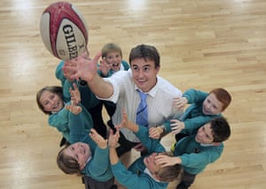 Teaching Awards 2010: A teacher throws a ball in the air surrounded by pupils looking up