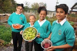 Teaching Awards 2010: Four pupils hold fruit and vegetables ready for composting