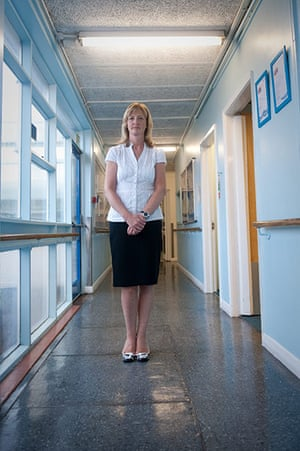 Teaching Awards 2010: A woman stands alone in corridor