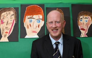 Teaching Awards 2010: A man smiles in front of children's paintings