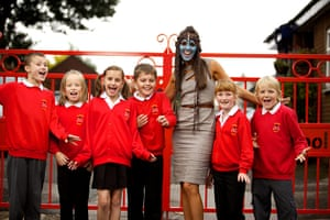 Teaching Awards 2010: A woman with a fun painted face stands amongst her smiling pupils