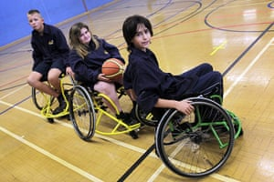 Teaching Awards 2010: Three pupils in wheelchairs pose on the basketball court.
