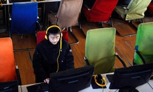 A customer uses computer in an internet cafe at Changzhi