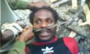 Tribal Papuan men are tortured, allegedly by Indonesian soldiers