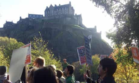 Demonstrators march past Edinburgh Castle in the STUC protest against cuts
