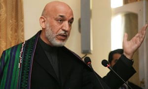 Afghan president, Hamid Karzai, tells a press conference he is happy to take cash from Iran