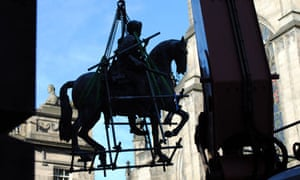 A crane lifts Charles II and his horse off the plinth in Parliament Square