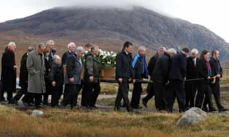 Mourners carry Linda Norgrove's coffin at her funeral on Lewis