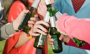 Drinkers with beer bottles.
