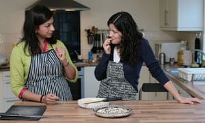 Monisha Bharadwaj and Homa Khaleeli taste their barfi.