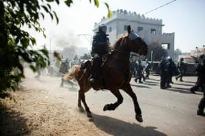 Israel Protest: A horse mounted riot police officer advances during clashes in Umm el-Fahm