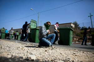 Israel Protest: An Israeli Arab collects stones during the riots in Umm el-Fahm