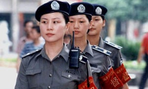 A team of police women patrol the street