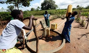 Edith Apiango collects water in Katine