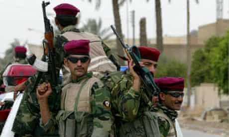 Members of the Wolf Brigade patrol Baghdad in 2005