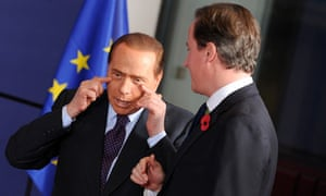 Silvio Berlusconi and David Cameron at an EU summit in Brussels on 28 October 2010.