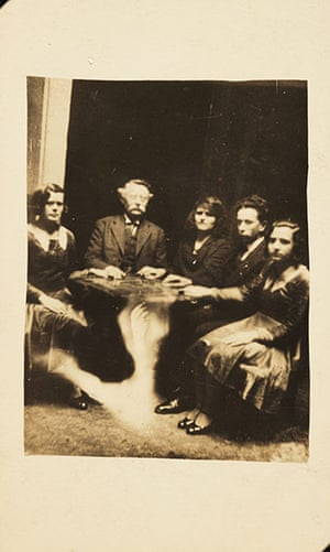 William Hope ghost pics: A photograph of a group gathered at a seance, taken by William Hope