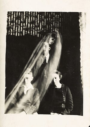 William Hope ghost pics: Woman with two boys and a female spirit, c 1920.