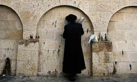 An ultra-Orthodox Jewish man prays outside Rachel's Tomb, known as Bilal bin Rabah mosque to Muslims