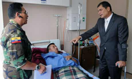 President Rafael Correa visits an injured soldier in Quito