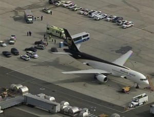 Cargo Terror: A UPS plane sits surrounded by law enforcement officials in Newark