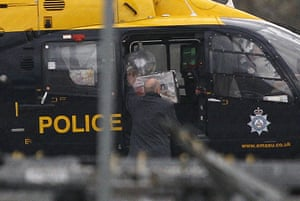 Cargo Terror: A package is loaded onto a police helicopter at East Midlands Airport