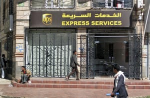 Cargo Terror: Yemenis walk past the UPS office in the capital San'a