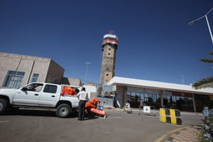 Cargo Terror: Workers load packages onto a truck at Sanaa International Airport