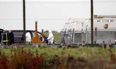 Security officials at East Midlands airport after an explosive package was found on a cargo plane