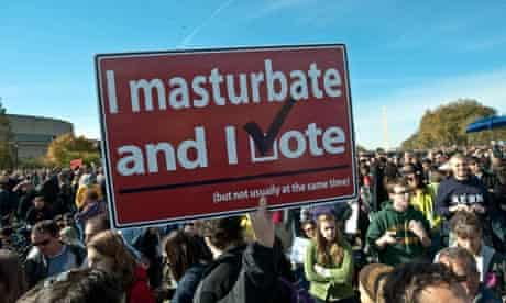i masturbate and i vote placard at rally to restore sanity
