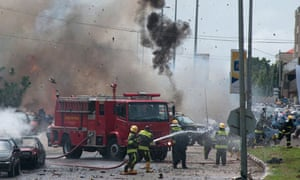 Smoke and debris fill the sky seconds after a car bomb explodes