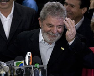 Brazil elections: President Luiz Inacio Lula da Silva gestures as he attends a conference