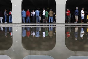 Brazil elections: People wait in line to vote during Brazil's general elections