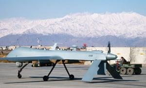 A US Predator unmanned drone sits primed at  Bagram air base, Afghanistan