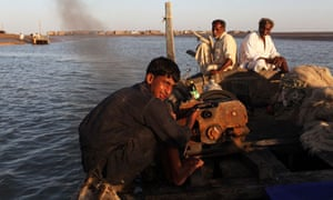 Pakistani fishermen on the Indus delta at dusk