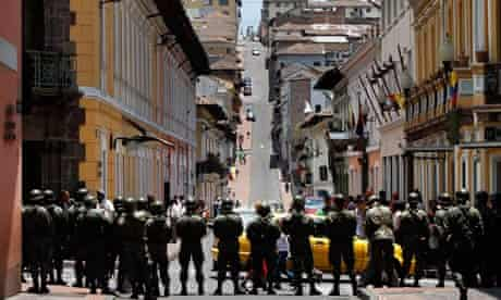 Soldiers guard Quito's presidential palace after an attack on the president, Rafael Correa