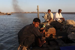 Sehwan Sharif Pakistan: Fishermen on the Indus delta at dusk