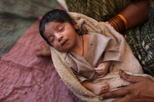 Sehwan Sharif Pakistan: Shehrban, a one-day old child held in his mother's arms