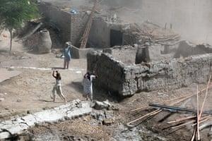 Sehwan Sharif Pakistan: Pakistani soldiers drop food aid to a village in Dadu district