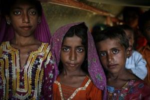 Sehwan Sharif Pakistan: Flood refugee children at their tent near the shrine in Sehwan Sharif