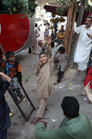 Sehwan Sharif Pakistan: Flood affected families load their luggage onto buses in Karachi