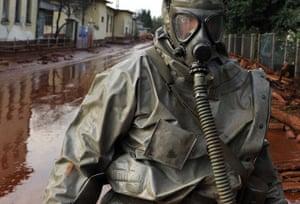 Hungary sludge flood: A Hungarian soldier wearing a chemical protection gear