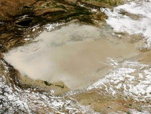 Satellite Eye on Earth  Dust storm over China's Taklimakan Desert
