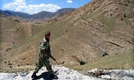 A Pakistani soldier patrols the border with Afghanistan in North Waziristan
