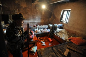 Toxic sludge Hungary: Jozsef Horvath stands in a room of his house covered with red mud, Devecser