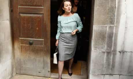 Elizabeth Saunders leaves the inquest into her husband Mark's death after the inquest verdict