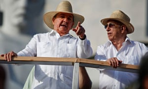 Raul Castro in a guayabera dress shirt